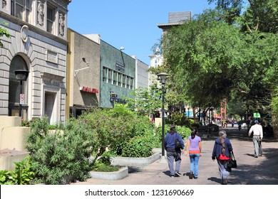 FRESNO, UNITED STATES - APRIL 12, 2014: People walk in Fresno, California. Fresno is the 5th most populous city in California (509,000 citizens).