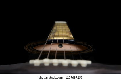 fretboard,sound hole and saddle of a handmade acoustic Guitar