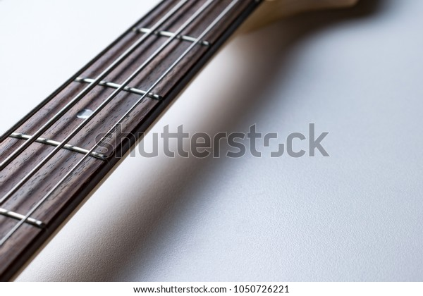 Frets on bass guitar. Close up. Vintage old retro bass in studio
