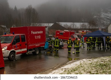 Freudenberg,NRW,Germany - 12.01.2020 : A group of fire fighters stay on a coordination point with air masks.