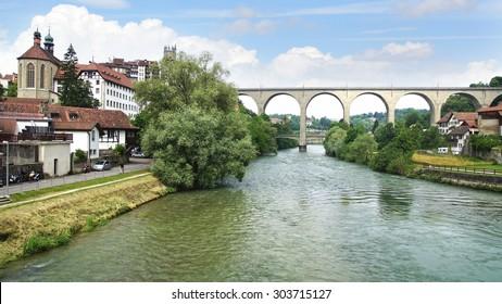 FRIBURG, SWITZERLAND - JUNE 16, 2015: Zaehringen bridge crossing the Sarine at Medieval town. The Zaehringen Bridge is arched double deck bridge was built in 1924.