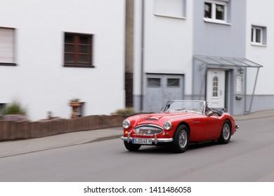 Frickenhausen, Germany - May 19, 2019: Austin-Healey 3000 british oldtimer roadster car at the 25. International Oldtimer-Rallye event.