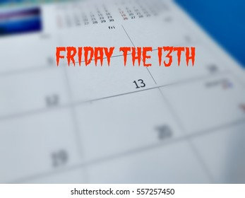 Friday the 13th concept image where calendar shown date of 13th on Friday with blurred background