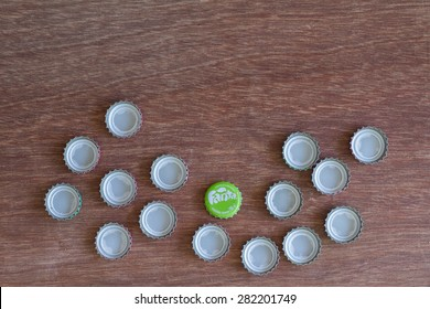 Friday, 29 May 2015: in Chiang Mai Thailand ,Fanta Bottle Caps on wood table.