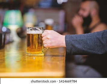 Friday leisure tradition. Beer pub concept. Weekend lifestyle. Beer mug on bar counter defocused background. Glass with fresh lager draft beer with foam. Mug filled with cold tasty beer in bar.