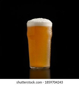 Friday night at pub with favorite alcoholic drink. Cold pint of beer or glass of light lager with foam and flowing down drops, isolated on black background, studio shot, free space, cut out - Shutterstock ID 1859704243