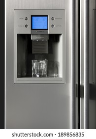 Fridge detail with ice dispenser and glass. Vertical