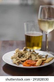 fried anchovies, white wine and beer at a street bar, Seville, Spain