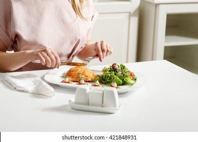 Fried beef with salad on white table. Stock image. Horizontal