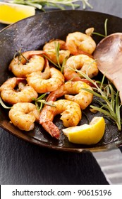 fried black tiger prawns with fresh rosmarin and lemon