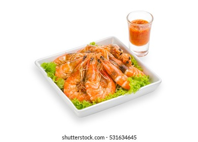 fried black tiger prawns with herbs and spices on white background