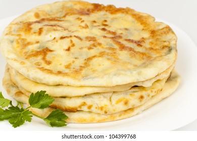 Fried bread with cheese - khachapuri, national Georgian dish