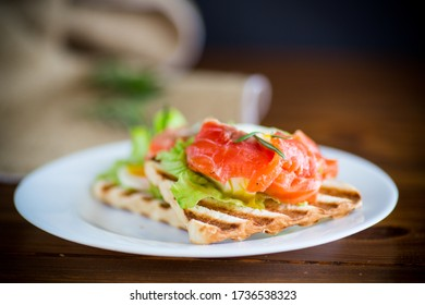 fried bread toast with salad leaves and salted red fish