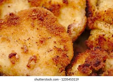 Fried breadcrumbs on meat