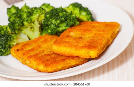 fried breaded fish fillets with broccoli