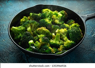 Fried broccoli in cast iron skillet, frying pan