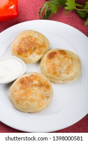 Fried buns stuffed with meat and vegetables