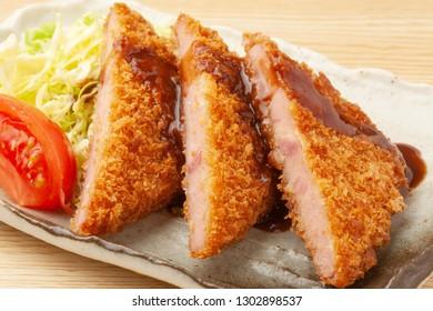fried cake of layered slices of ham