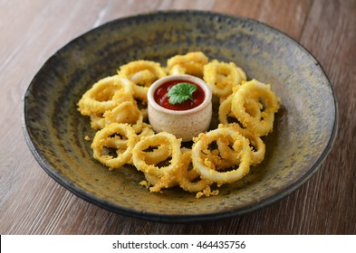 Fried calamari rings with sauce, Spanish tapas