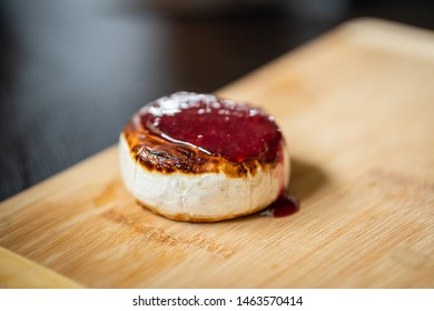 Fried camembert with raspberry sauce