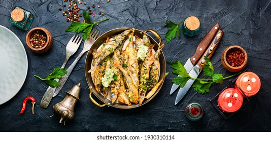 Fried capelin fish with herbs and lemon zest