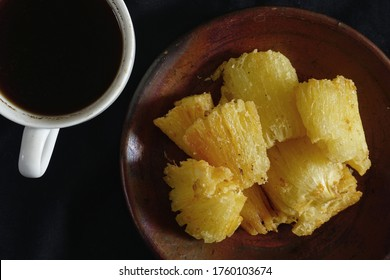 Fried cassava or Ketela Goreng is a traditional food usually served as a snack along with hot tea or black coffee in Indonesia. Similar with Brazilian food Mandioca Frita or fried manioc
