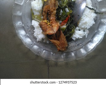 fried catfish and kale vegetables