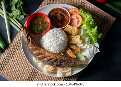 Fried catfish rice with sambal, popular traditional Malay or Indonesian local food. Flat lay top down overhead view.