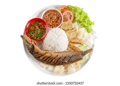 Fried catfish rice with sambal, popular traditional Malay or Indonesian local food. Isolated on white background. Flat lay top down overhead view.