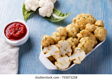 fried cauliflower in batter on a wooden surface