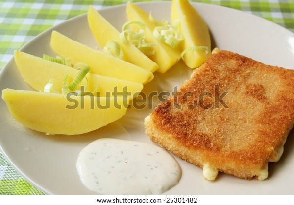 Fried cheese with potatoes, traditional czech meal