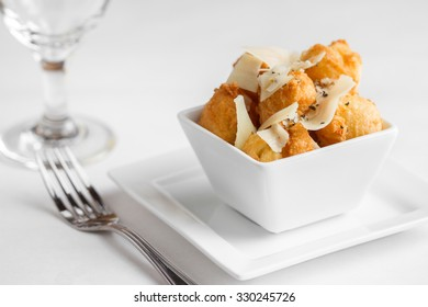 Fried cheese puffs with cracked black pepper