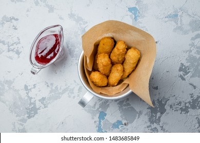 fried Cheese sticks with berry sause on grey concrete table