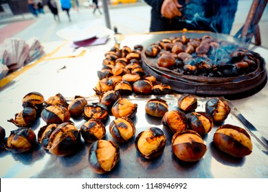 Fried chestnuts on the street. Street food. Roasted chestnuts