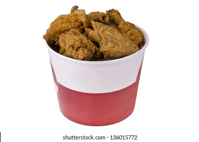 Fried chicken in big red white bucket box, isolated on white.