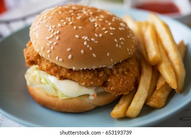 fried chicken burger and french fries for meal