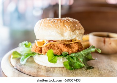 fried chicken and cheese burger with french fries