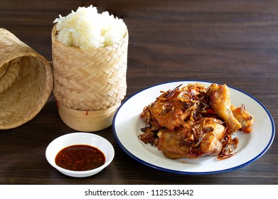 Fried chicken with chili and fifh sauce delicious thai food eating with sticky rice,/ Select focus, and space for texts