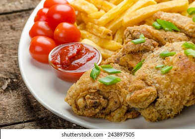 Fried chicken, chilli fries and dip and spring onions on top of meal