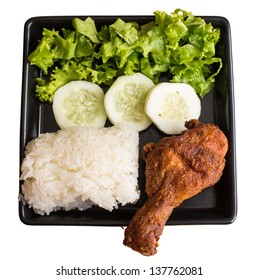 fried chicken with cucumber and lettuce in white background