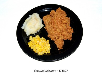 A fried chicken dinner on a white background