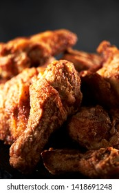 Fried chicken with dramatic lighting
