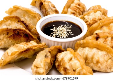Fried Chicken Dumplings served with hoisin sauce topping with sesame seed.