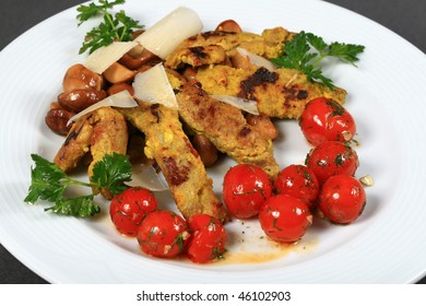 fried chicken fillets, mushrooms and stewed tomatoes, small red