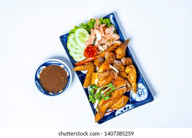 Fried chicken with fish sauce on white background