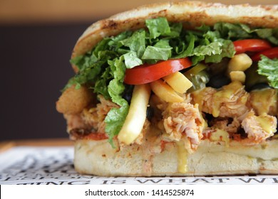 Fried Chicken Hoagie Sandwich with lots of vegetables fries