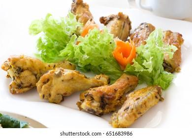 Fried chicken leg in plate