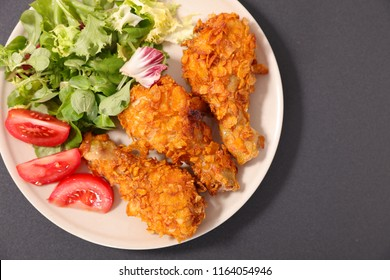 fried chicken leg and salad