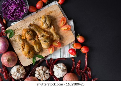 Fried chicken legs on choping board with many vegetable and curry . flat lay image with space for your text.