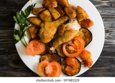 Fried chicken legs with vegetables. Tasty and nutritious dish.